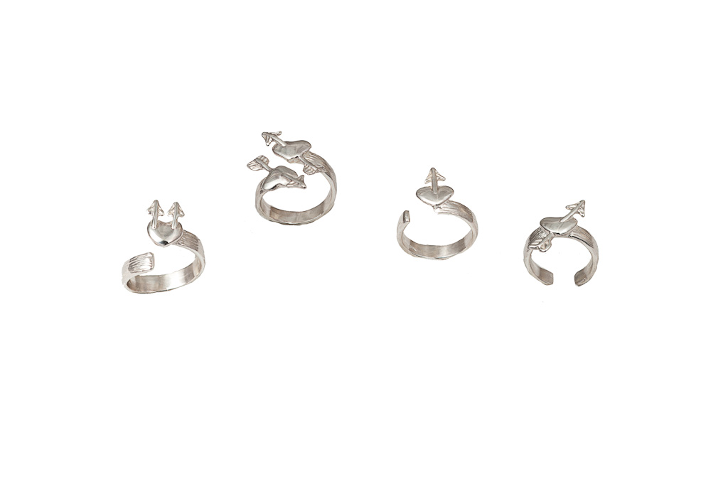 Set of 4 silver rings with heart and arrow