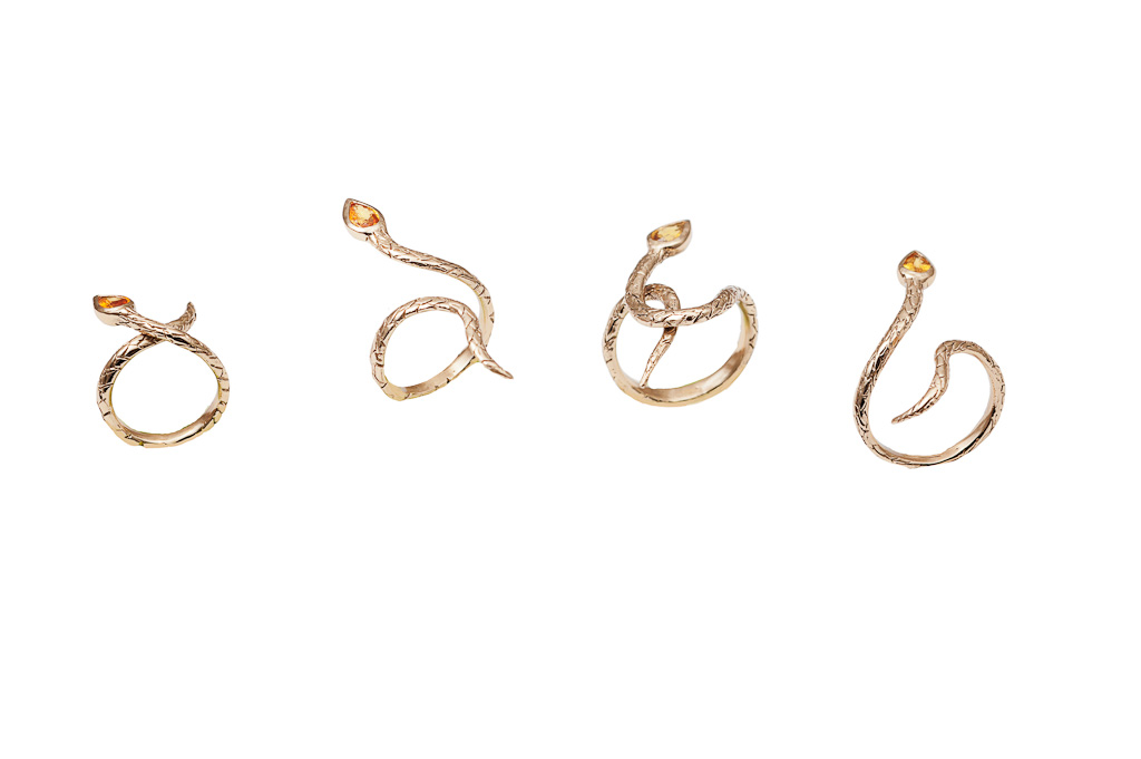 set of 4 bronze snakes rings with sapphires