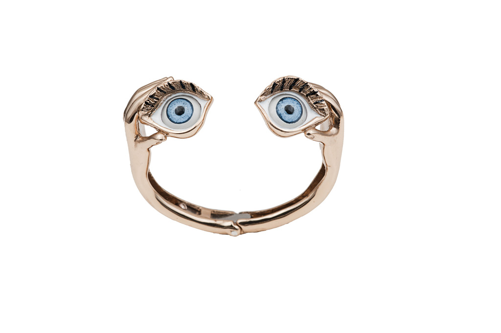 Bronze stiff bracelet with hands and eyes