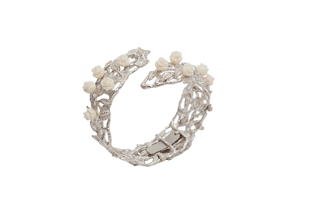 Silver leafy cuff bracelet with white resin roses