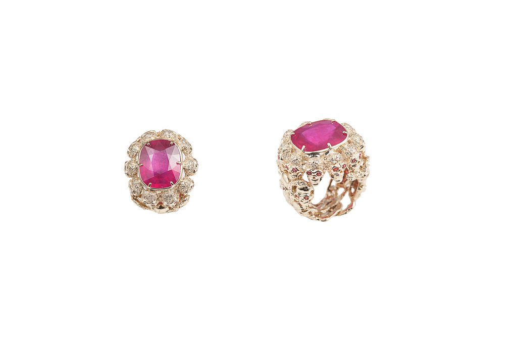 Skulls and snakes ring with glass-treated ruby