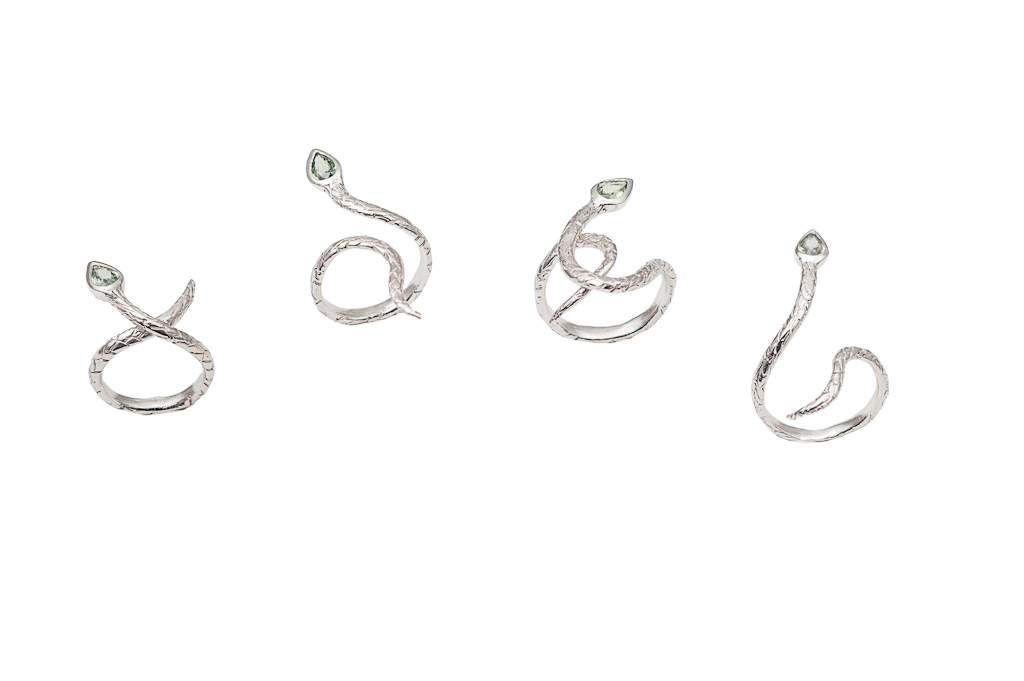 set of 4 silver snakes rings with sapphires