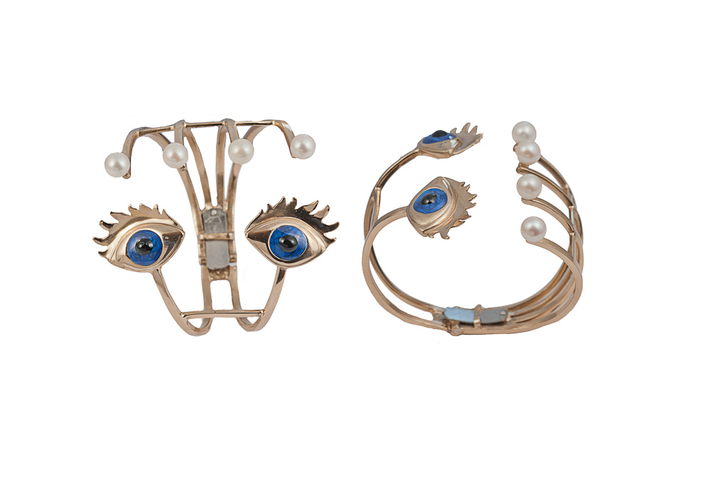 Bronze bracelet with enamelled eyes and pearls