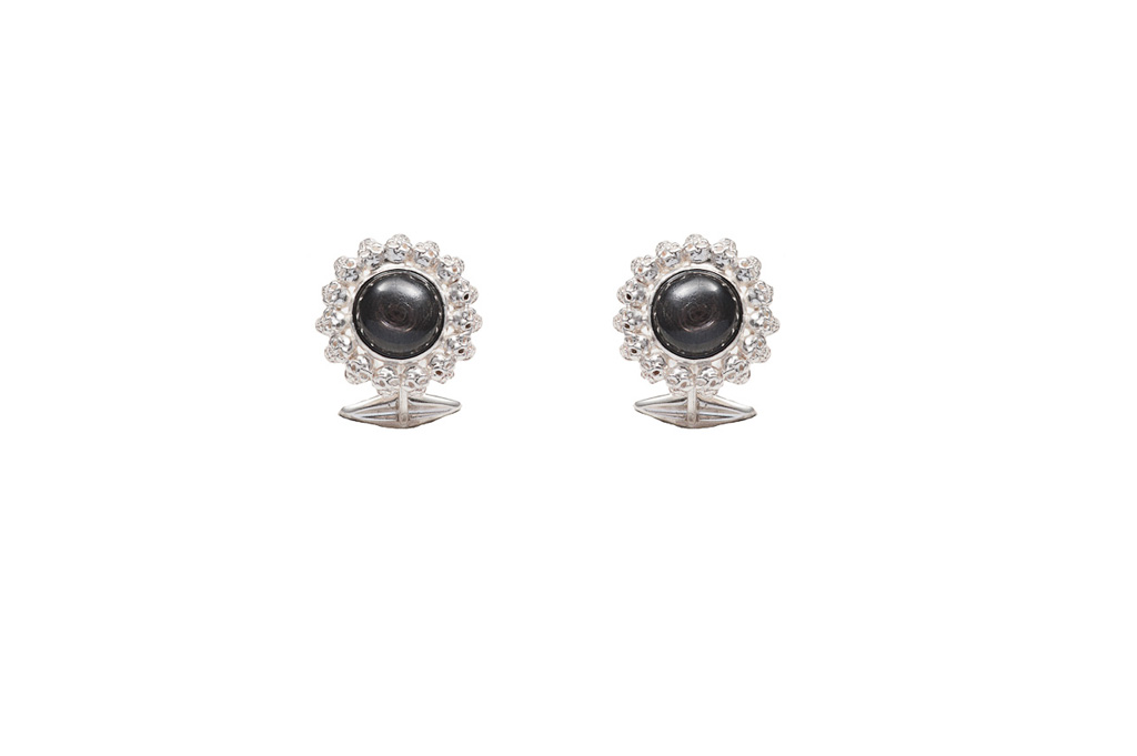 Silver all skulls cufflinks with black star