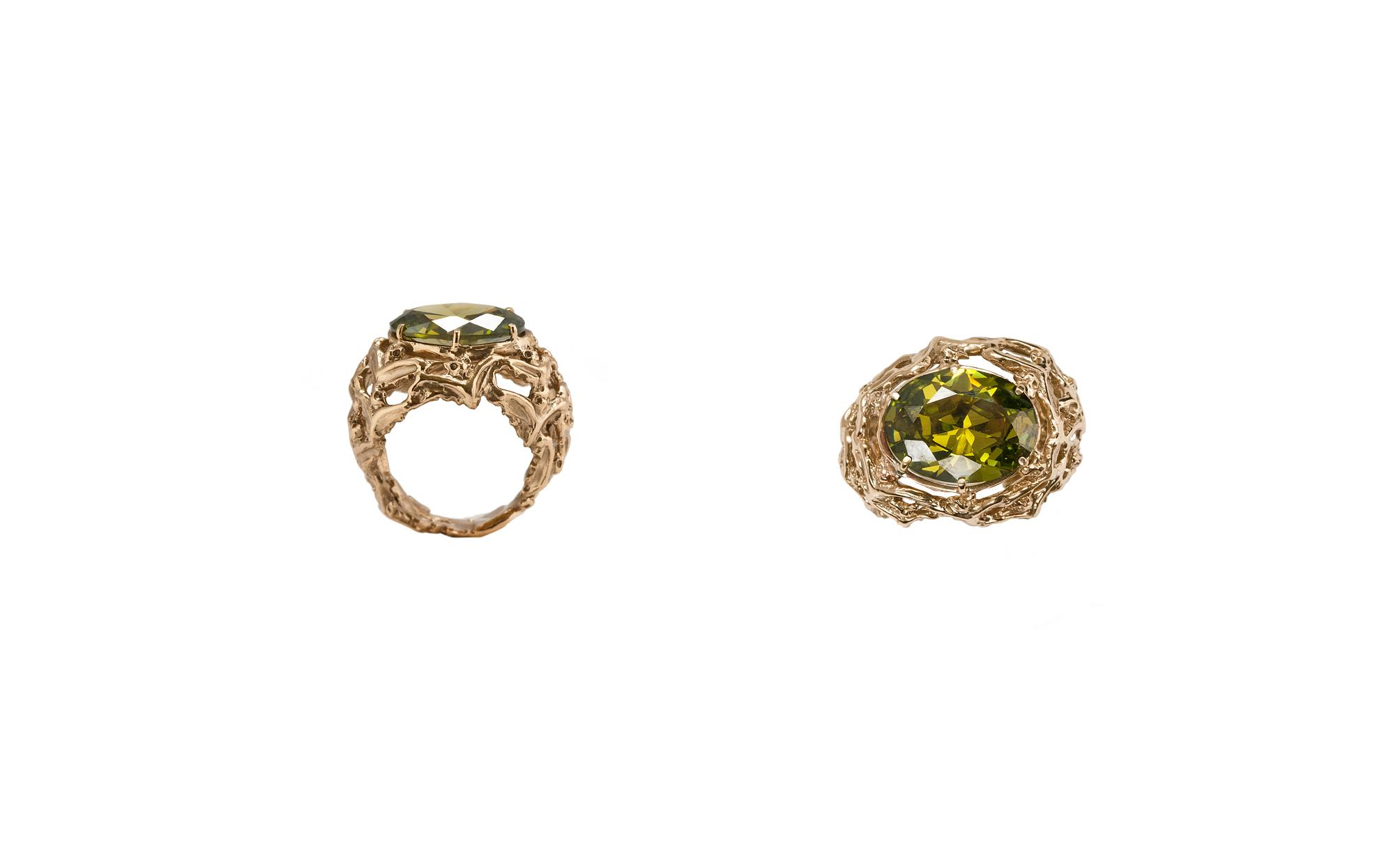Bronze bats dome ring with green zircon