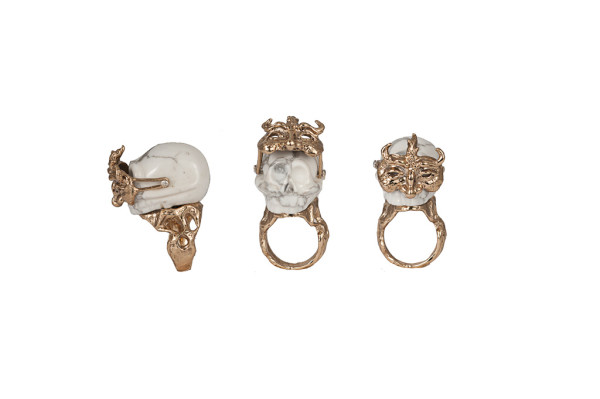 Marble skull ring with sliding bronze mask