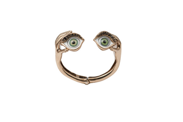 Bronze stiff bracelet with hands and green eyes