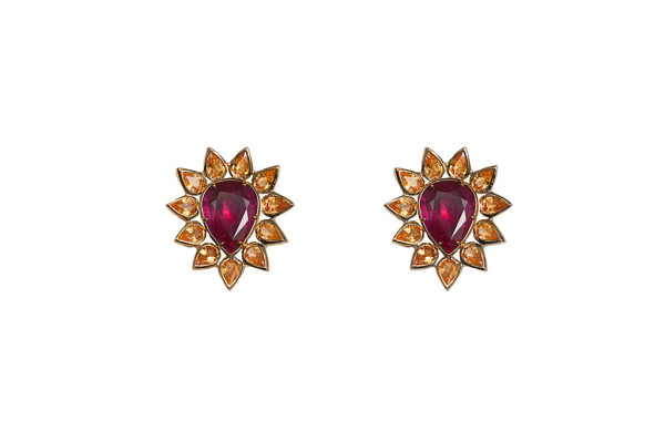 Gold earrings with glass-treated rubies and yellow sapphires drops