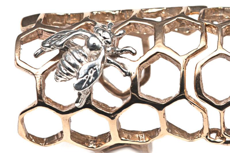 Bronze knuckle honey comb ring with silver bee