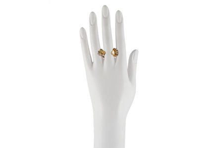 Bronze cupped hands ring with yellow cubic zirconia