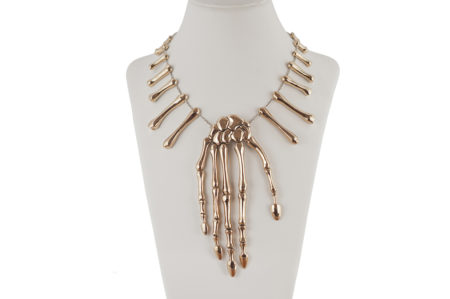 Bronze skeleton hand necklace