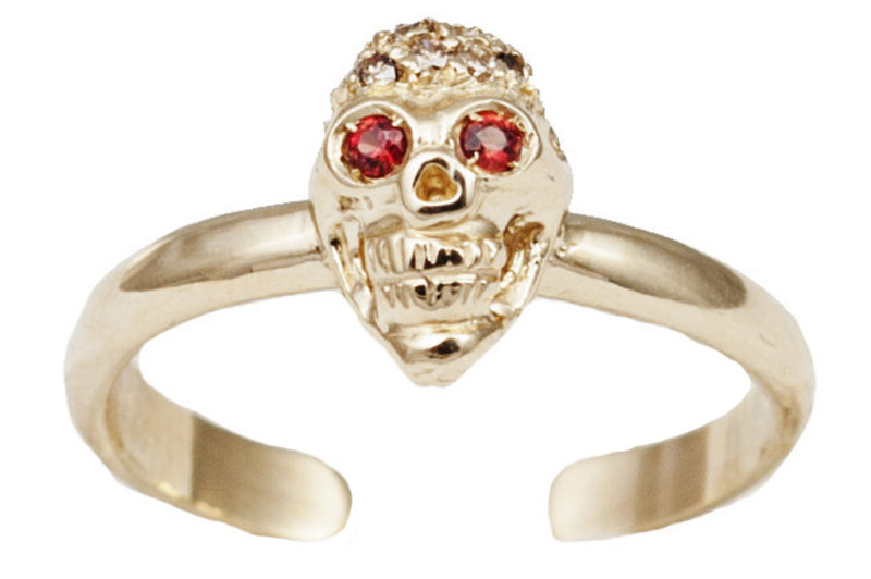Gold band ring with diamonds pavé skull with tsavorites eyes