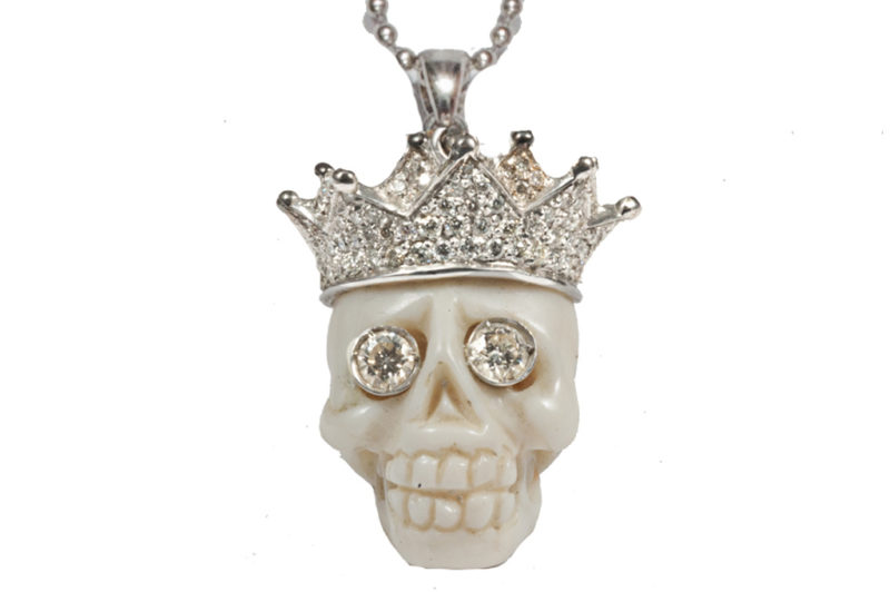 Gold necklace with coral skull, pavé crown, diamonds eyes