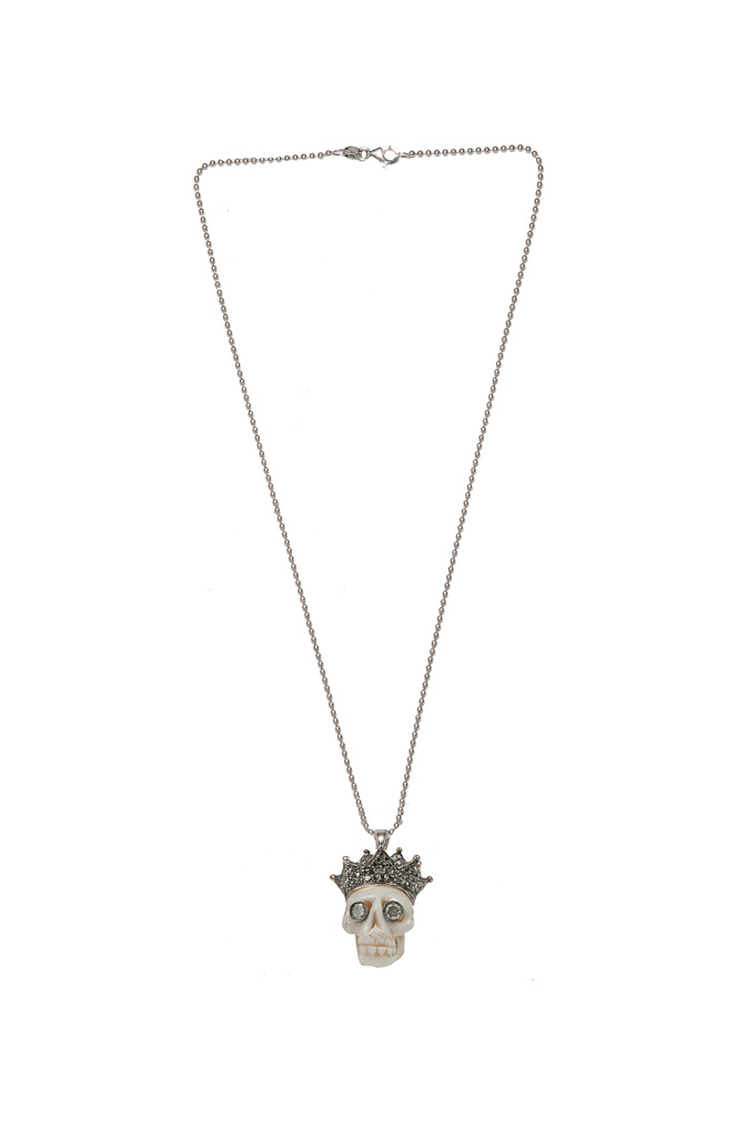 Gold necklace with coral skull, black pavé crown, grey diamonds eyes