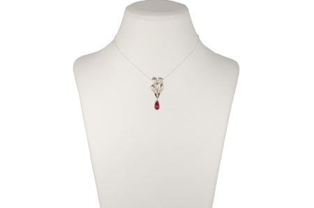 Four hands pendant with glass-treated ruby, chain is included