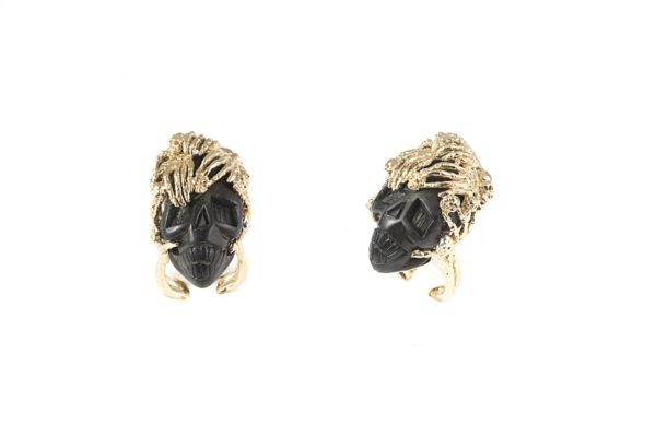 Bronze skeleton hands ring with ebony skull